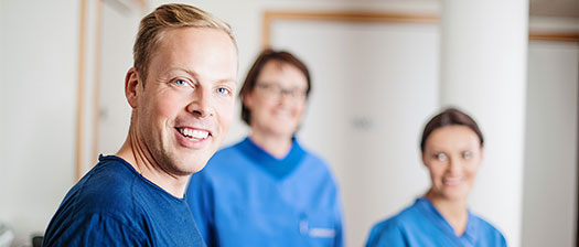 Three allied health professionals smiling