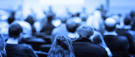 Blue image of crowd at a conference