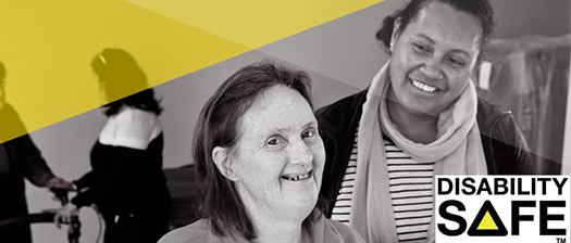 Two people smiling together with the Disability Safe logo in front