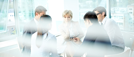 A group of people in a meeting room in discussion