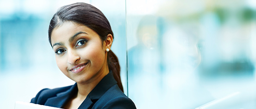 Woman smiling to camera in an office environment
