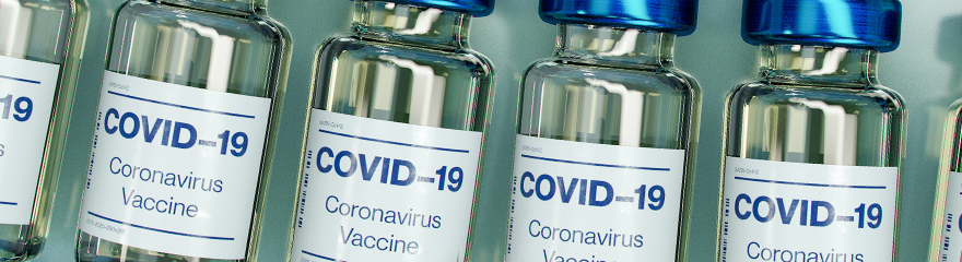 A row of vials labelled COVID-19 vaccine