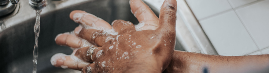 Close up of a person washing their hands