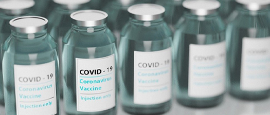Row of COVID-19 vaccine vials