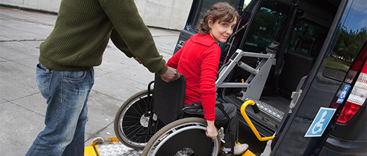 girl in a wheelchair going into vehicle