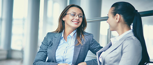 Two women in an office environment in discussion