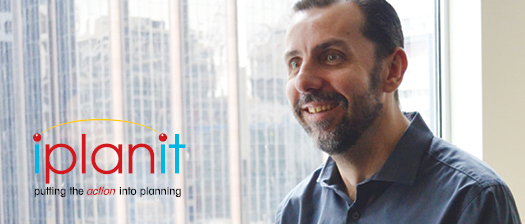 Person smiling by a window and the iplanit logo