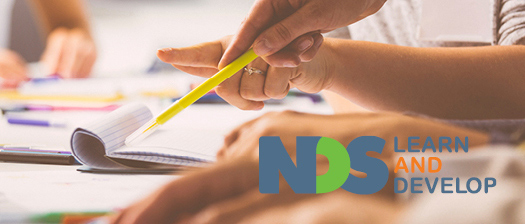 NDS Learn and Develop logo alongside a person taking notes