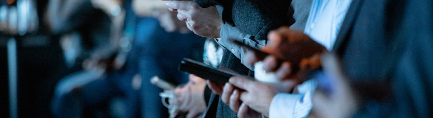 several business people tapping smart phones