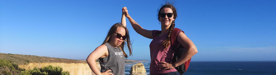 Image of participant and support person doing exercise with an ocean view