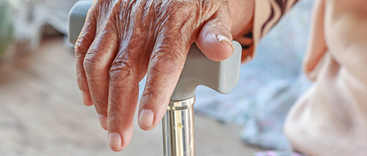 Hand resting on a cane