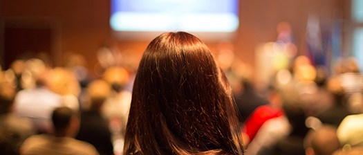 Woman looking over audience