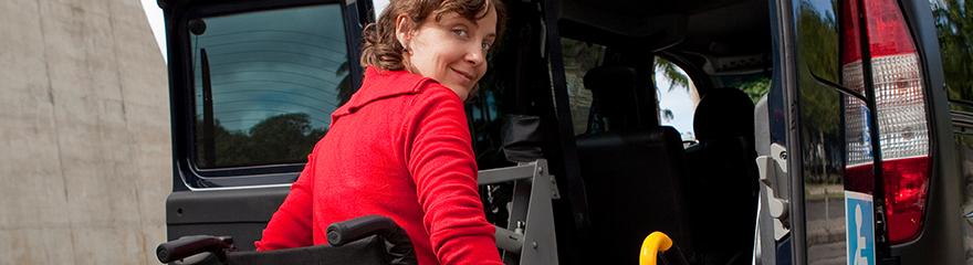 Person in a wheelchair entering a taxi