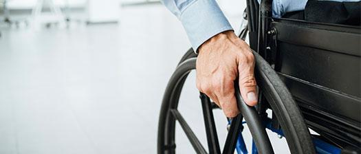 Hand on a wheelchair wheel