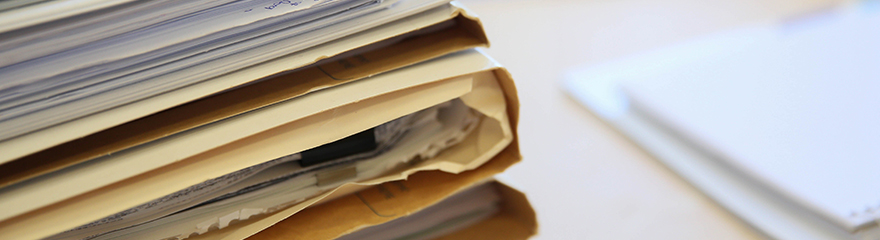 Files full of papers on a desk