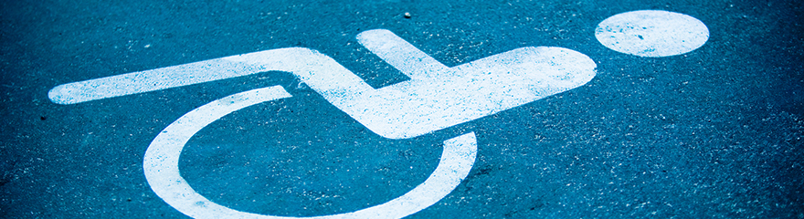 Wheelchair symbol painted on a parking space