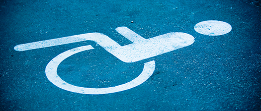 Image of disabled parking logo on pavement