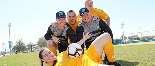 Australian soccer team posing and laughing