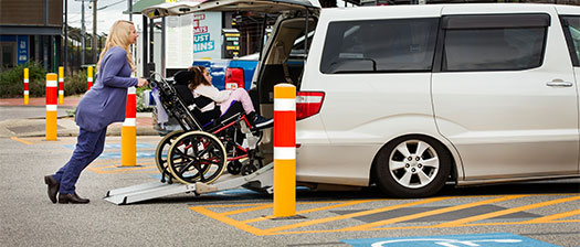 Woman using disability transport