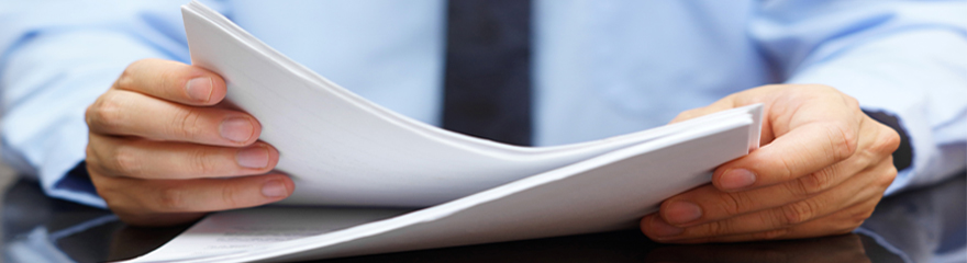 Person holding a paper document.