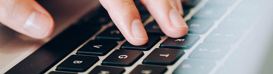 Hands on a laptop keyboard
