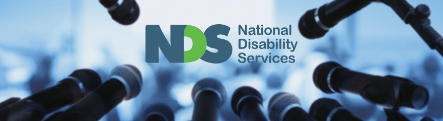 NDS media release banner with photo of a microphone