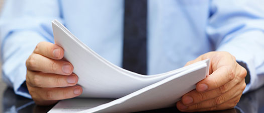 Person holding a paper document