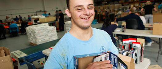 Person smiling at work in a warehouse