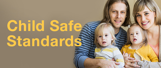 Family smiling with text reading 'Child Safe Standards'
