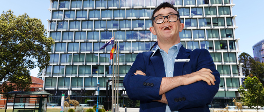 Joe Salt happily standing outside a multi-storey building
